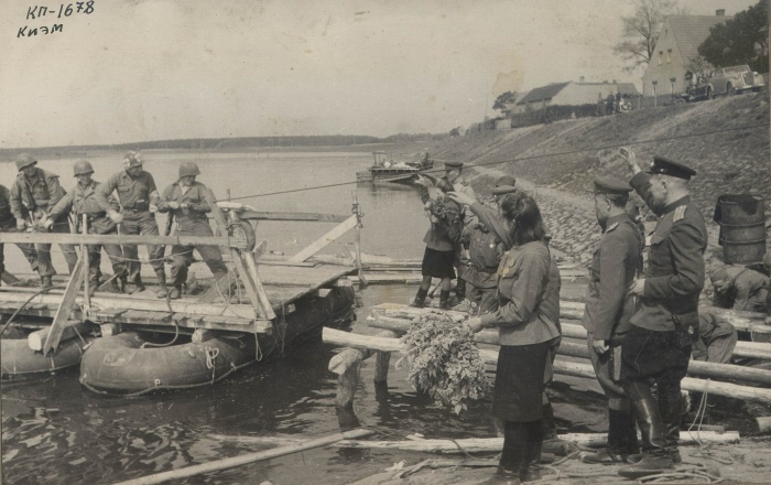 """Americans on the raft (from left to right) are Bob Haag, Ed Ruff, Carl Robinson and Byron Shiver. This photo appeared in the """"Komsomolskaya Pravda"""" issue shown above."""