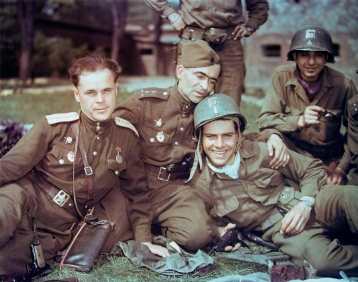 American Lieutenant Dwight Brooks (center, in helmet) smiles as he and other members of the 69th Infantry Division pose with Soviet officers from the 58th Guards Division in the German town of Torgau, Germany, late April, 1945. Photo by PhotoQuest/Getty Images. Source: waralbum.ru