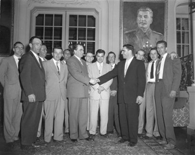 Elbe veterans visit Soviet Ambassador. Soviet Ambassador Georgi Zarubin, left, shakes hands with Murray Schulman of Queens Village, N.Y. as a group of U.S. Army veterans who participated in the Elbe River link-up with Russian troops 10 years ago call on him. April 25, 1955 the Russian Embassy in Washington, D.C. Left to right are: Edwin Jeary, Robert Haag, Byron Shiver, John Adams, Charles Forrester, Zarubin, William Weisel, Yuri Gouk, Soviet second secretary, Elijah Sams, Schulman, Robert Legal, Fred Johnston and Claude Moore (AP Photo/John Rous). Source: AP Images .
